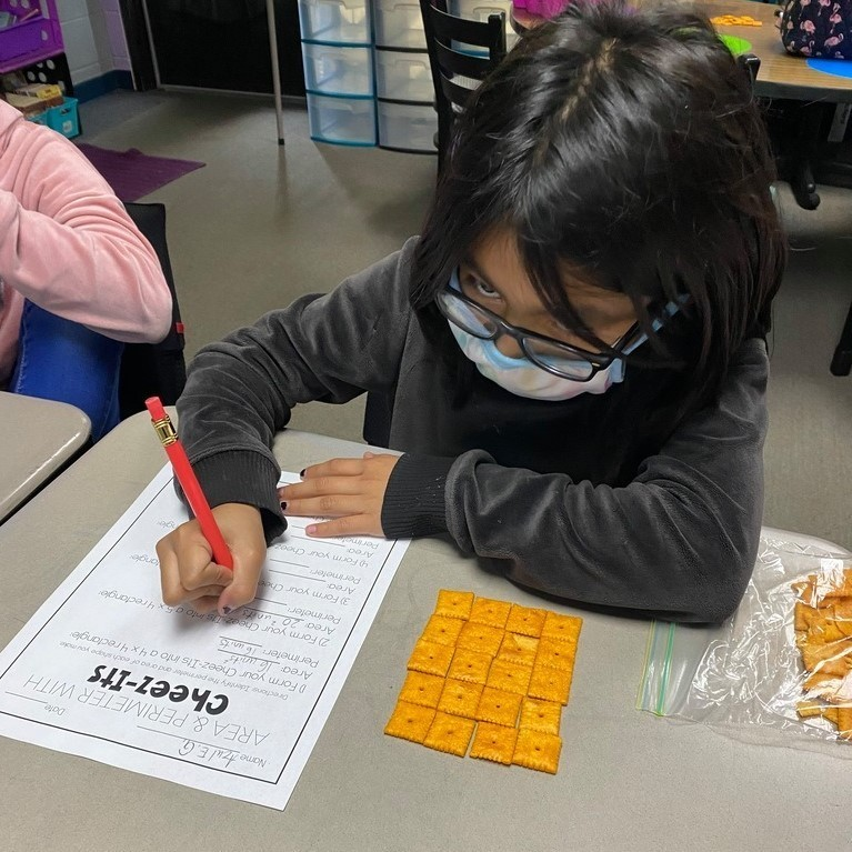Mrs. Castle's 3rd grade WIN group practices area and perimeter with Cheezits.