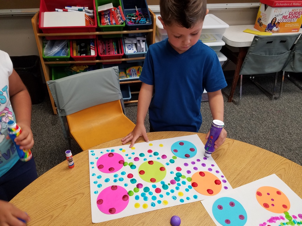 Student creating dot artwork