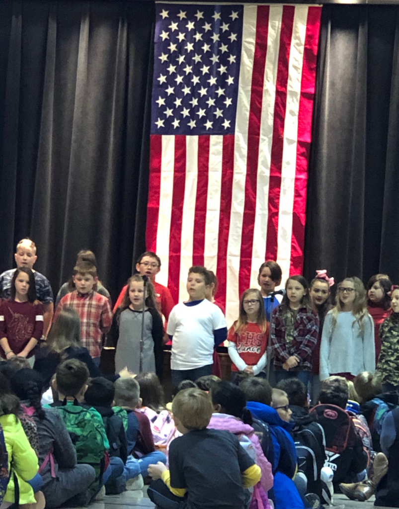 Students singing the national anthem.