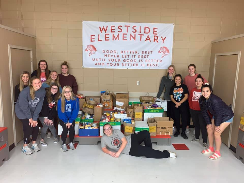 CHS girls basketball helped Westside pack up food baskets for fellow Zebra families.