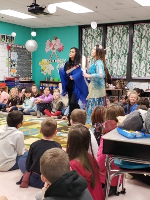Teacher performs authentic Kiowa dance for students.