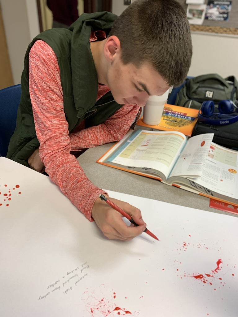 Forensic Science class recreate blood evidence.