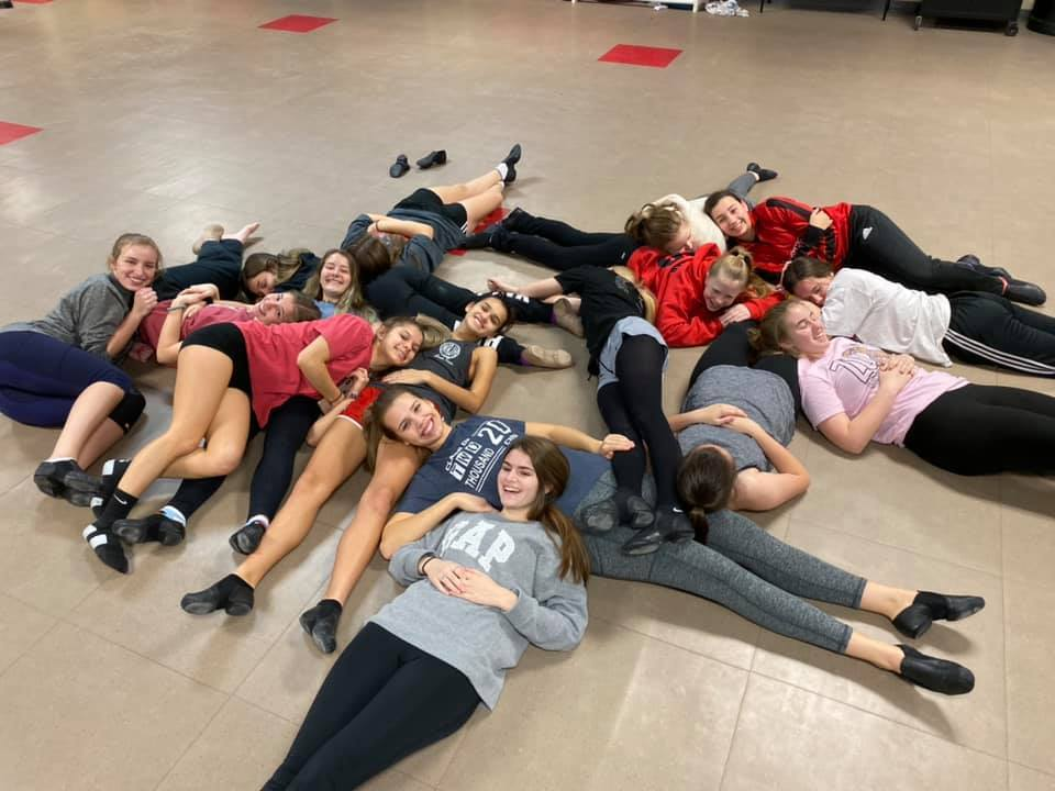 Dance team takes break after an all out state dance practice.