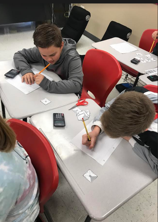 Ms. Lohmann's 6th grade Advanced Math class took what they knew about combining like terms to solve a puzzle