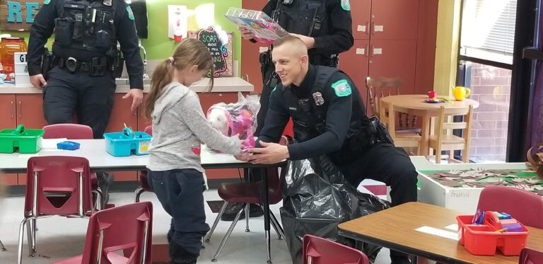Officer giving gift