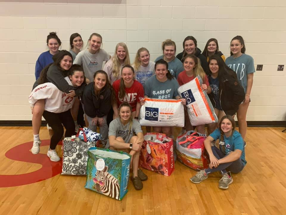 CHS Volleyball player sharing the true gift of giving this season.