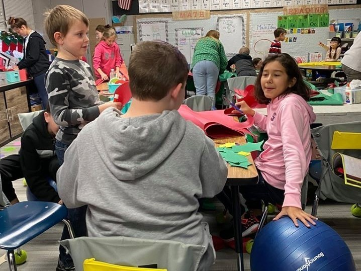 "At Roosa Mrs. Page's 1st grade class and Mrs. Kropp's 5th grade class get together each week for ""book buddies."""