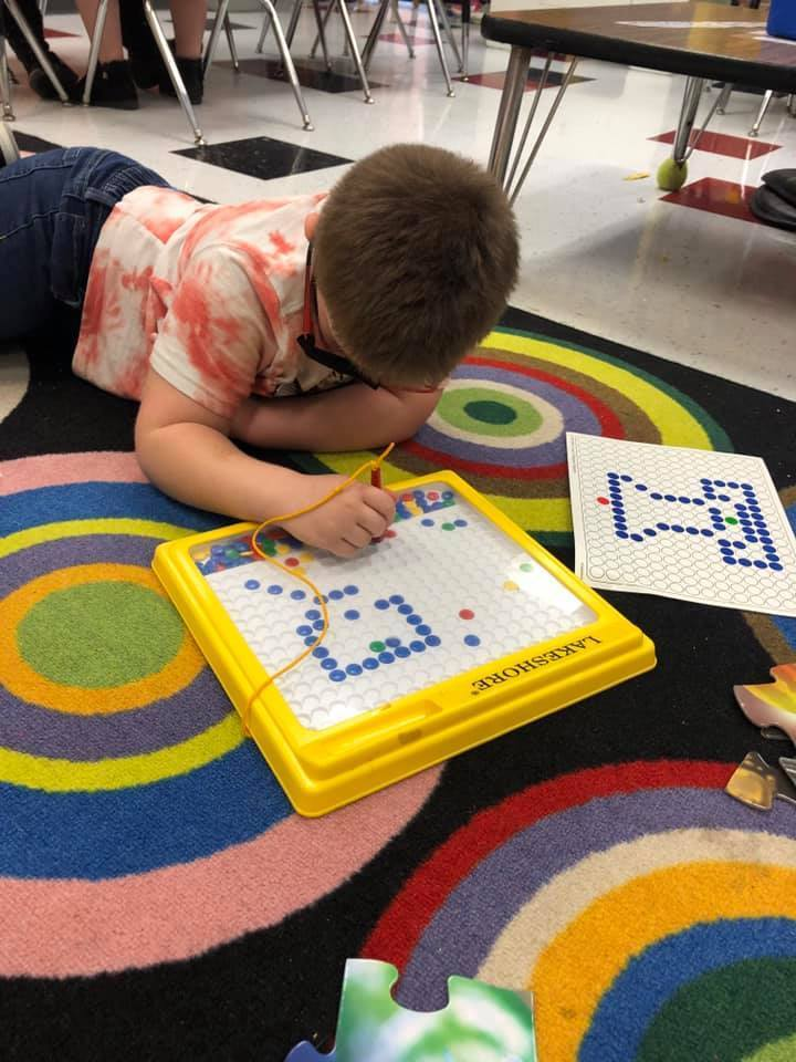 Claremont students play with manipulatives