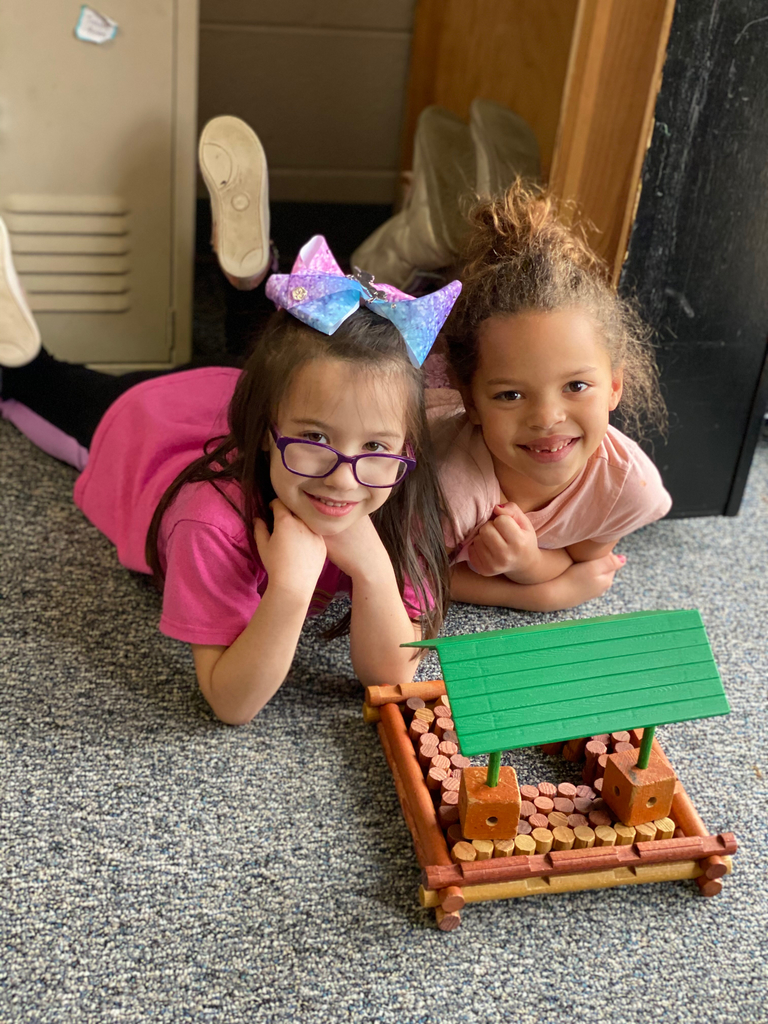 Girls building log cabin