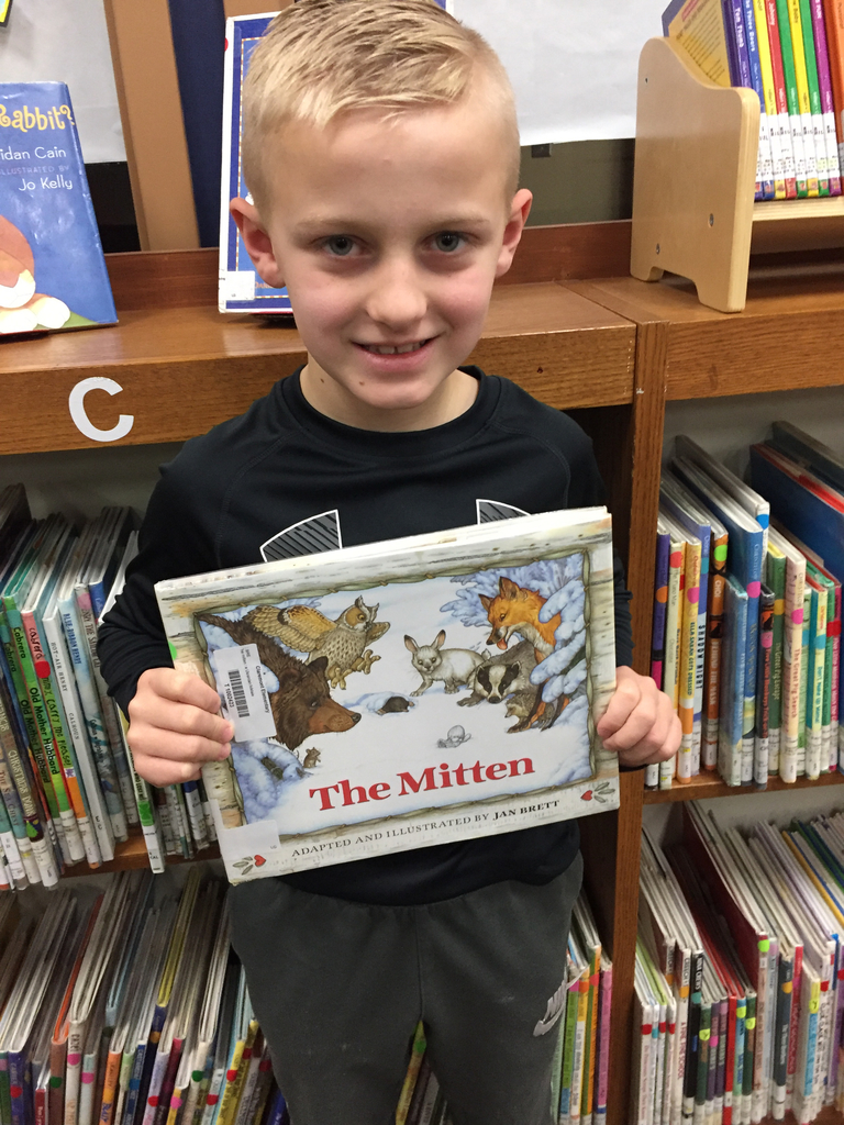 "Student with the book ""The Mitten"""