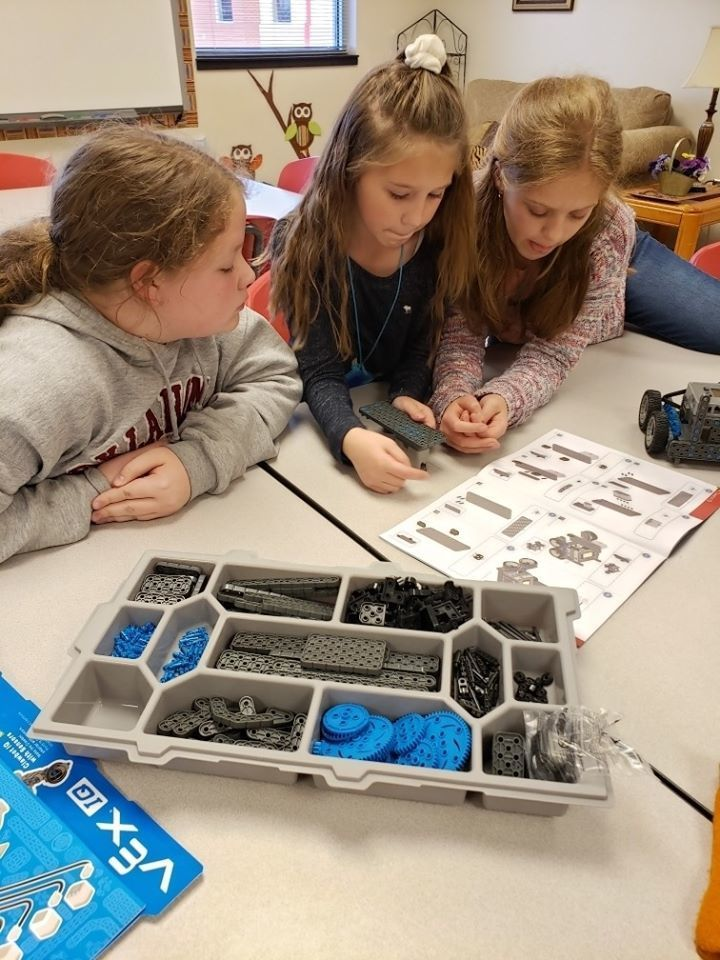 Miss Hall and the STEM club build their robots