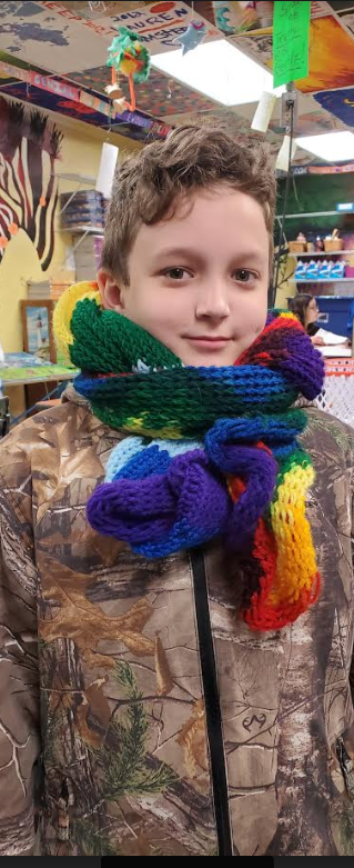 One of Mrs. Miller's art students created a multi-purpose scarf knitted on a loom.
