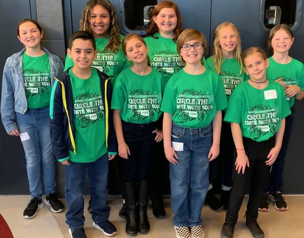 "Mrs. Shilling's 6th-grade choir students went to Owasso High School and participated in the ""Circle the State with Song"" festival."