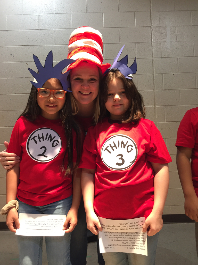 Teacher with students dressed as Thing 2 and Thing  3